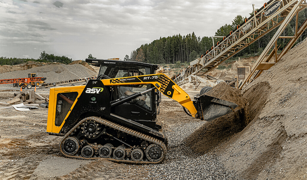 track loader with dirt